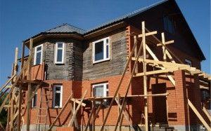 Як обкласти дерев'яний будинок цеглою