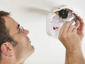 iStock-10990519_Changing-Battery-Smoke-Detector_s4x3_lg